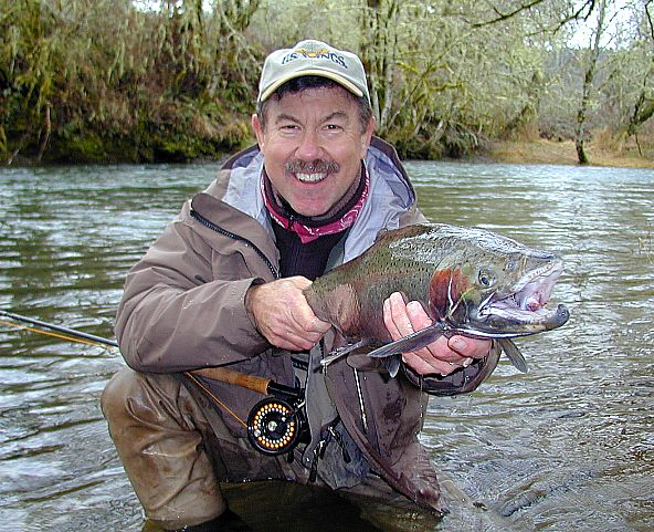 Michael G with smiling Alsea steelhead / trout and steelhead fly fishing / McKenzie River fly fishing guide